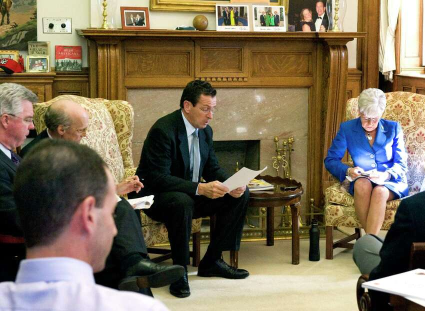 Among the proposed changes to the governor's office in the State Capitol, are major changes to the fireplace, seen here behind for Gov. Dan Malloy and Lt. Gov. Nancy Wyman, in a 2011 file photo.