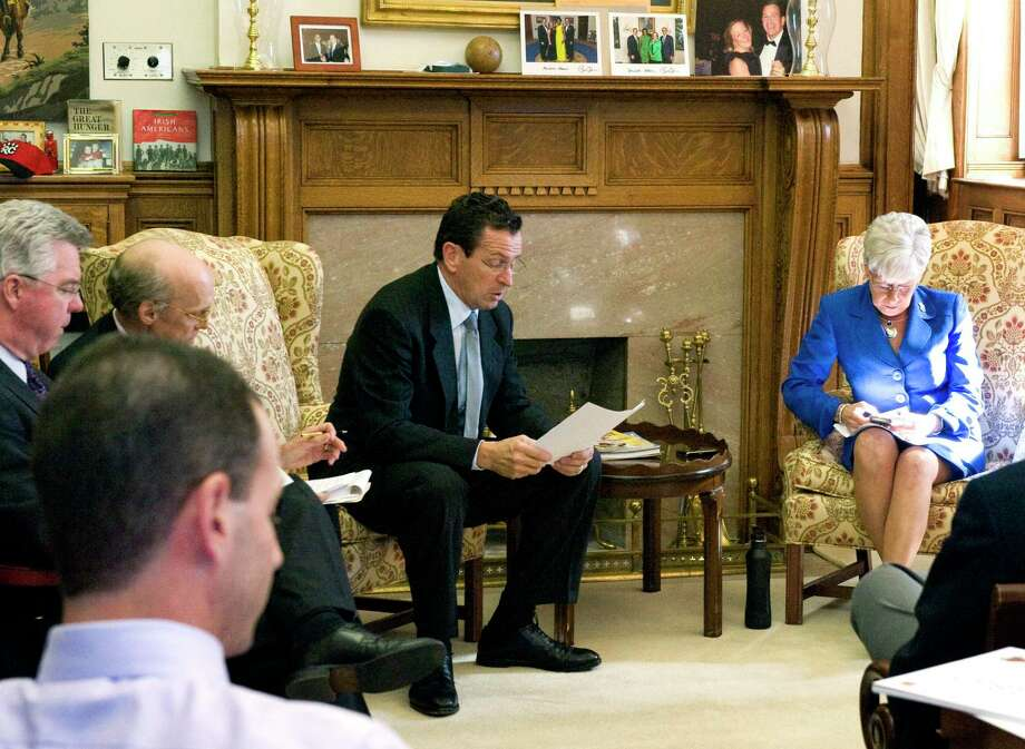 Among the proposed changes to the governor's office in the State Capitol, are major changes to the fireplace, seen here behind for Gov. Dan Malloy and Lt. Gov. Nancy Wyman, in a 2011 file photo. Photo: Keelin Daly / Keelin Daly / Stamford Advocate