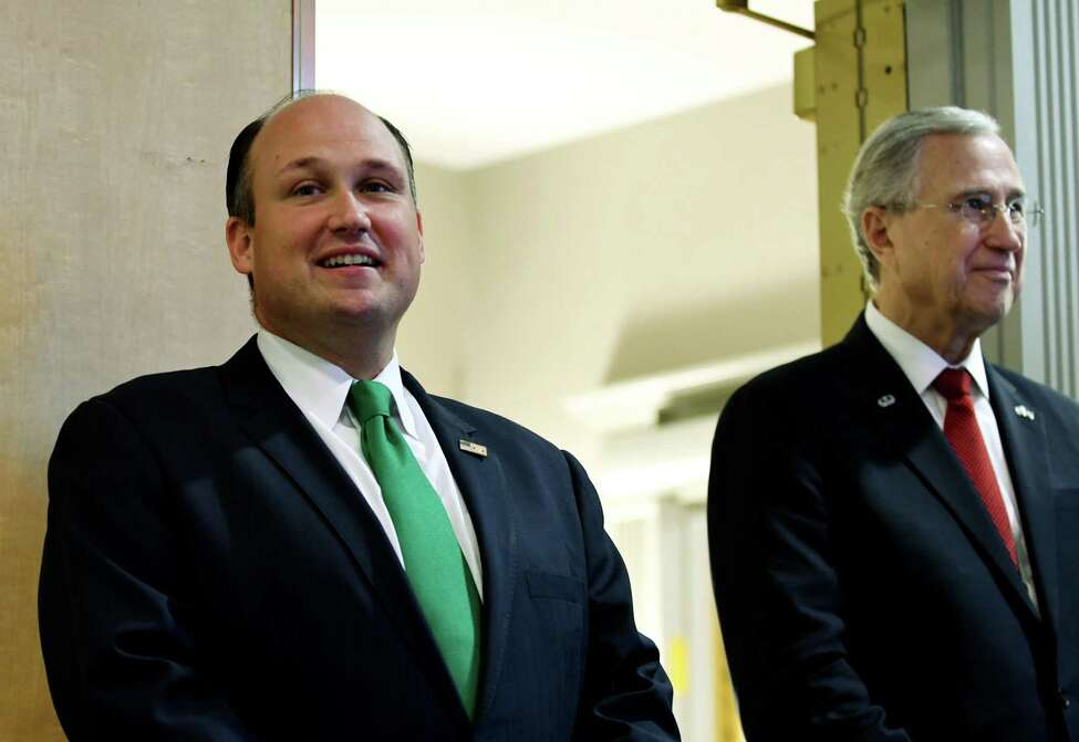 Newly elected New York State Republican Chairman, Nick Langworthy, left, and outgoing chairman Ed Cox, right, listens to speakers during the annual state Republican reorganizational meeting on Monday, July 1, 2019, at the Marriott in Colonie, N.Y. (Will Waldron/Times Union)