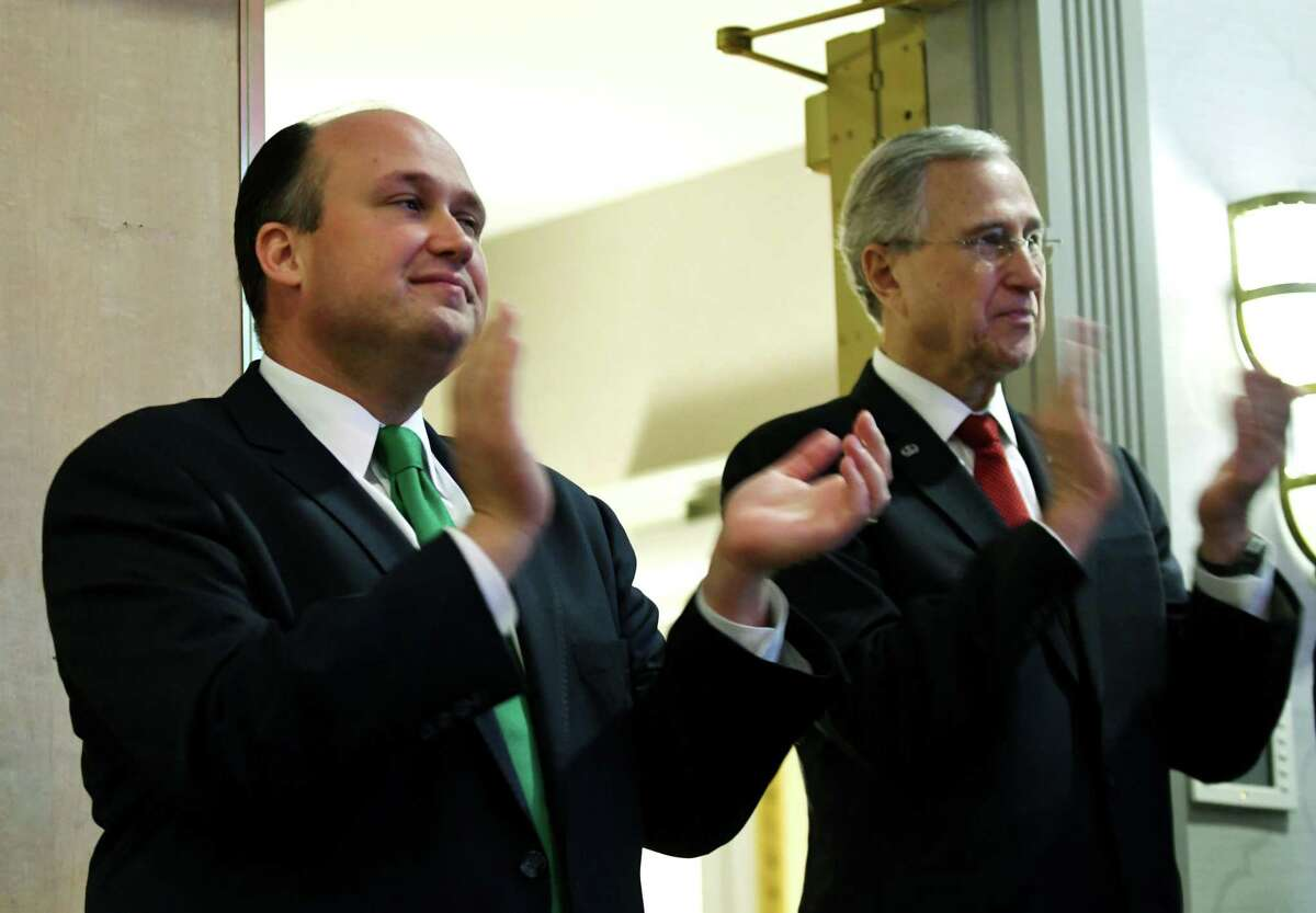 Newly elected New York State Republican Chairman, Nick Langworthy, left, and outgoing chairman Ed Cox, right, applaud speakers during the annual state Republican reorganizational meeting on Monday, July 1, 2019, at the Marriott in Colonie, N.Y. (Will Waldron/Times Union)