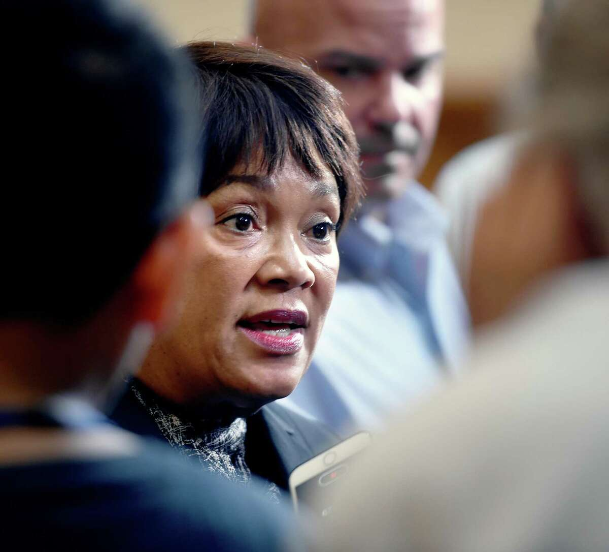New Haven Mayor Toni Harp (center) speaks with the press after announcing a comprehensive lead mitigation plan at City Hall in New Haven on July 1, 2019