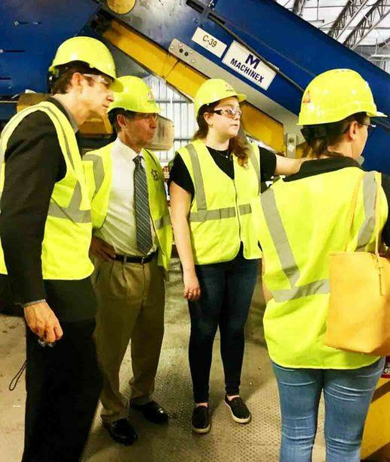 (L-R) Republic Services Leadership Trainee Megan Sexton (center) gives Madison County Chairman Kurt Prenzler a tour of Republic's Material Recovery Facility in Hazelwood, Mo. on Friday with Planning and Development Deputy Administrator Chris Doucleff and Sustainability Coordinator Andrea Campbell Yancey. Madison County and City of Collinsville officials took the tour of the facility that recycles 300 tons of material daily Photo: Courtesy Of Madison County