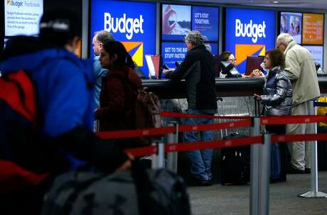 Travelers check-in at the rental car center at San Francisco International Airport in San Francisco, Calif. on Saturday, March 3, 2018.