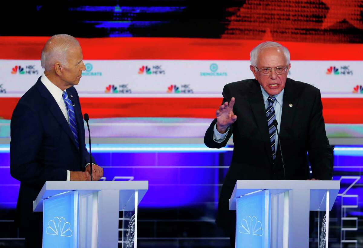 Democratic presidential candidate Sen. Bernie Sanders, I-VT, right, speaks during the Democratic primary debate hosted by NBC News at the Adrienne Arsht Center for the Performing Arts in Miami on June 27, 2019. To the left is former Vice-President Joe Biden.