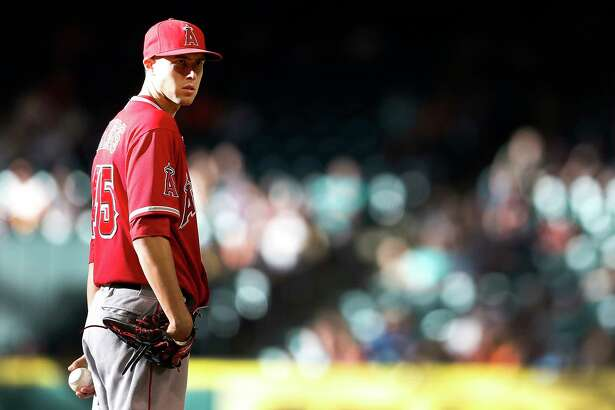 Los Angeles Angels starting pitcher Tyler Skaggs (45) pitches during the first inning of an MLB baseball game at Minute Maid Park, Thursday, June 5, 2014, in Houston.