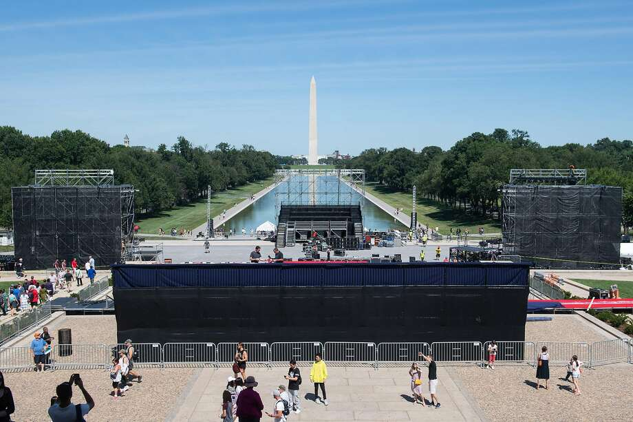 """Workers build a stage and bleachers for the """"Salute to America"""" Fourth of July event with US President Donald Trump at the Lincoln Memorial on the National Mall in Washington, DC, July 1, 2019, which will feature flyovers by the Blue Angels, an airplane used as Air Force One, as well as military demonstrations and a speech by Trump. Photo: Saul Loeb, AFP/Getty Images"""