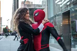 """This image released by Sony Pictures shows Zendaya, left, and Tom Holland in a scene from """"Spider-Man: Far From Home."""" (Jay Maidment/Columbia Pictures/Sony via AP)"""