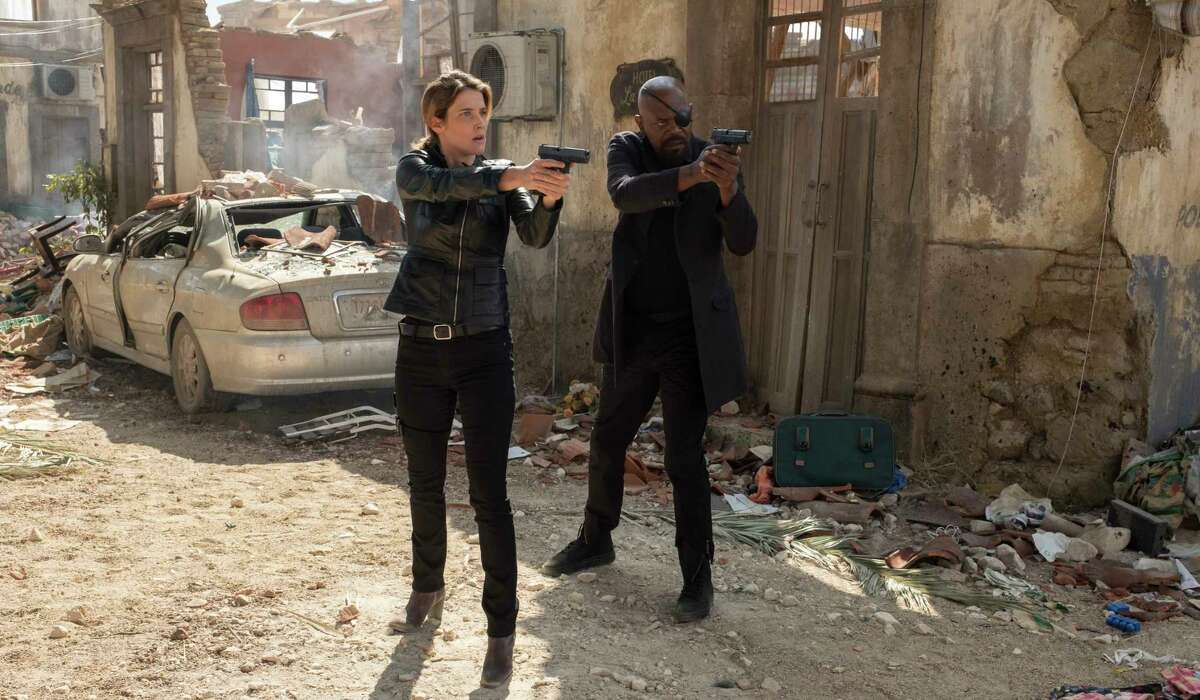 This image released by Sony Pictures shows Cobie Smulders, left, and Samuel L. Jackson in a scene from
