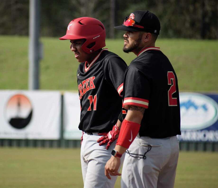 Kristopher Carroll, right, is the new head baseball coach at Caney Creek High School. Photo: Submitted Photo