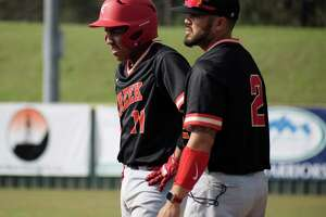 Kristopher Carroll, right, is the new head baseball coach at Caney Creek High School.