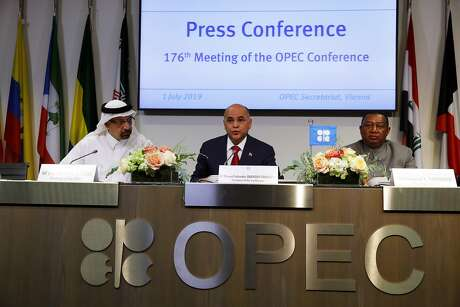 Manuel Quevedo, Venezuela's petroleum minister and president of the Organization of Petroleum Exporting Countries (OPEC), center, speaks while Khalid Al-Falih, Saudi Arabia's energy and industry minister, left, and Mohammad Barkindo, secretary general of OPEC, listen at a news conference following the 176th OPEC meeting in Vienna, Austria, on Monday, July 1, 2019. OPEC will extend production cuts into 2020 as the world's leading oil exporters fret about a weakening outlook for global demand growth and the relentless rise in output from America's shale fields. Photographer: Stefan Wermuth/Bloomberg