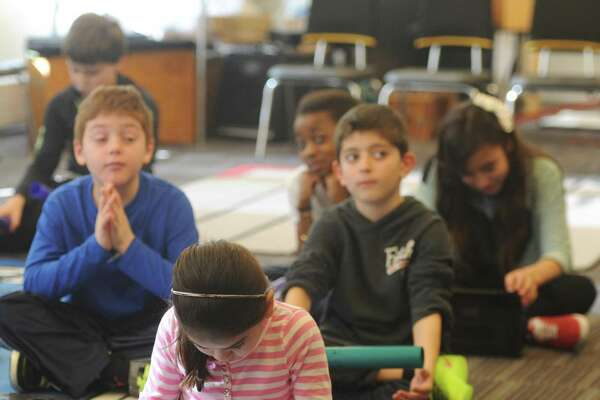 Students use iPads in music class at Hamilton Avenue School in Greenwich, Conn.