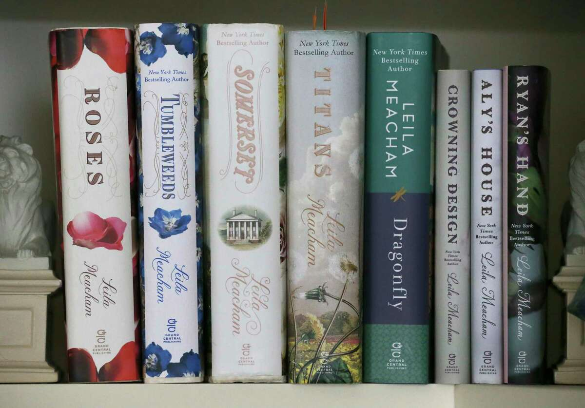 Copies of books by New York Times best selling author Leila Meacham are seen on a shelf.