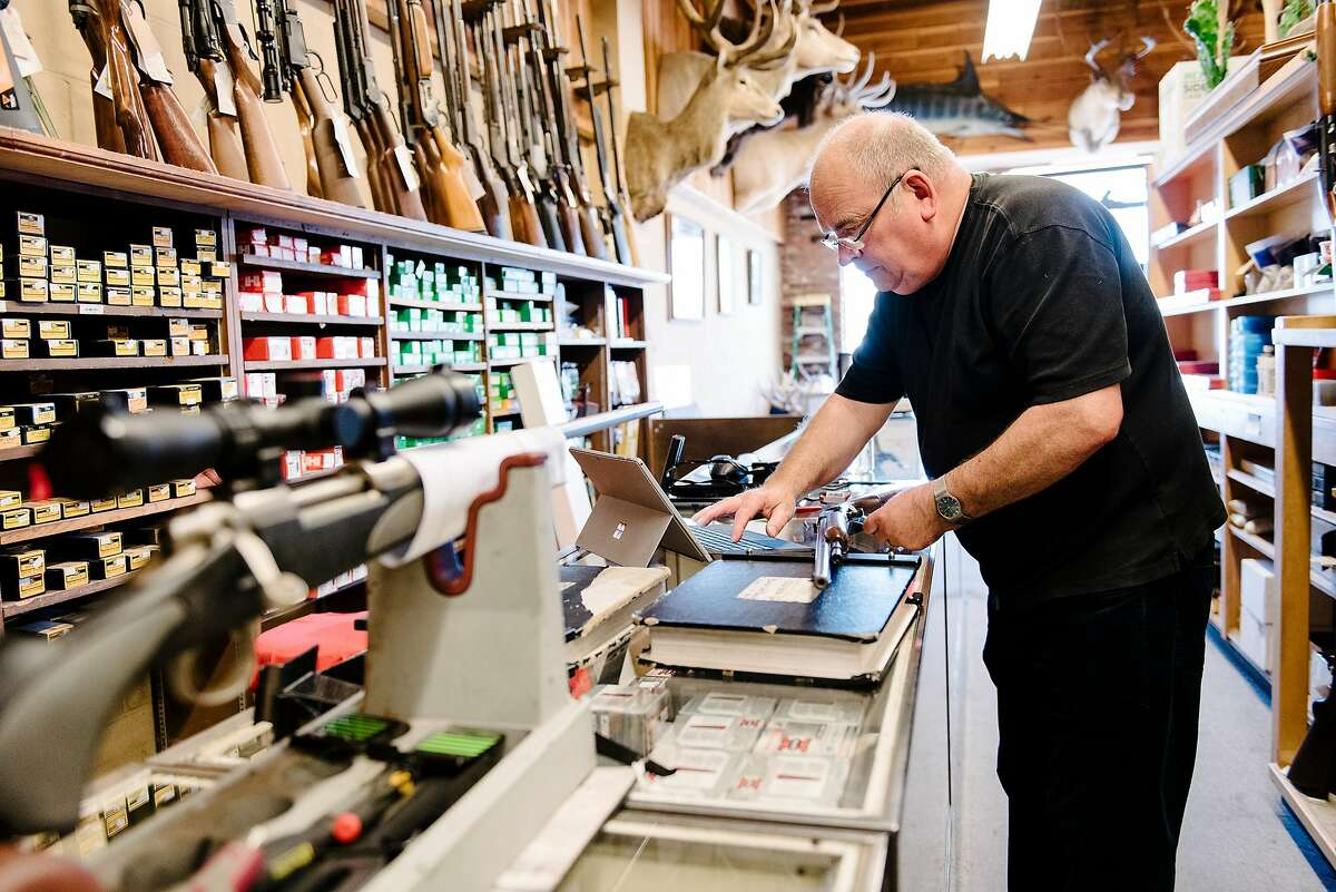 Employee George Morgan checks a gun while performing an inventory audit at Imbert & Smithers Inc. gunshot in San Carlos, CA on July 1st, 2019.