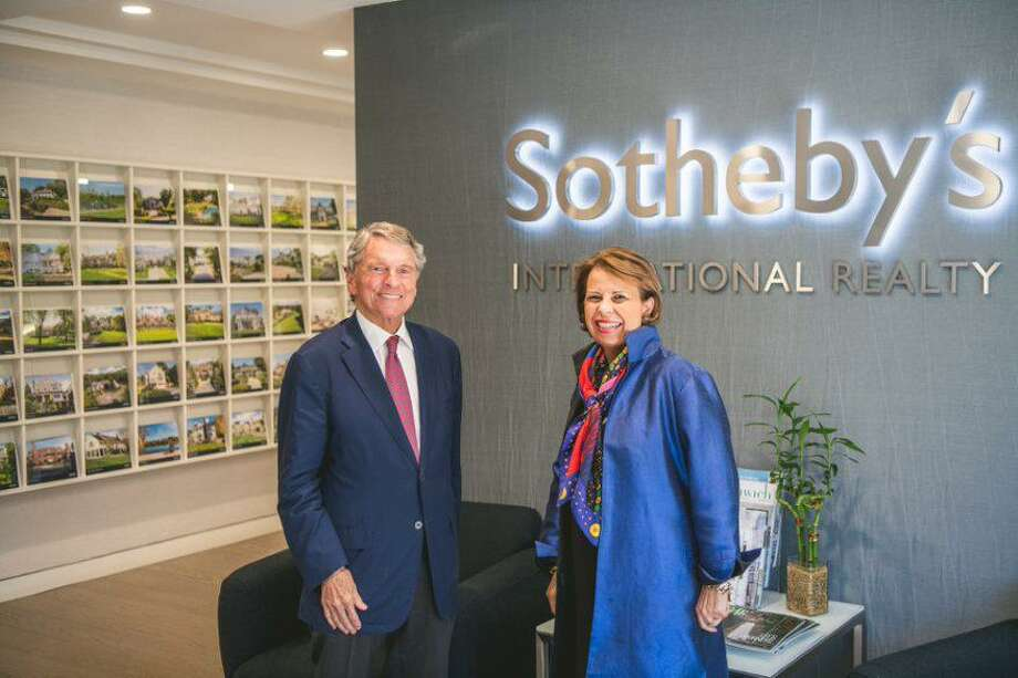 David Ogilvy and Pam Pagnani stand in Sotheby's International Realty's Greenwich office. Ogilvy is closing his Greenwich-based real estate brokerage David Ogilvy & Associates and joining Sotheby's, along with eight of his colleagues. Pagnani is the Sotheby's Greenwich brokerage manager. Photo: Contributed Photo