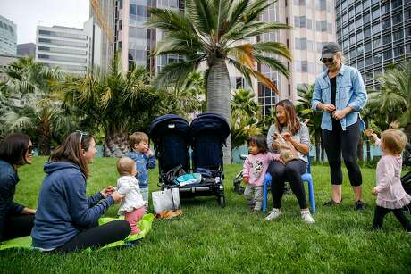 From left, Stephanie Hudson, Hellen Sparrow and children Jaimie Sparrow, 9 months, Joshua Sparrow, 2; laugh with Jaz Aiwazian, 1, and her mother Yili Aiwazian and McKenzie Armstrong and her daughter Amelia Armstrong, 1, as they meet for a playdate at the reopened Salesforce Park Monday, July 1, 2019, in San Francisco, Calif. The Salesforce Transit Center was initially opened in August 2018 but closed a month later after a cracked beam supporting the rooftop was discovered. After a nine month construction period to fix the issue the rooftop park has now reopened.
