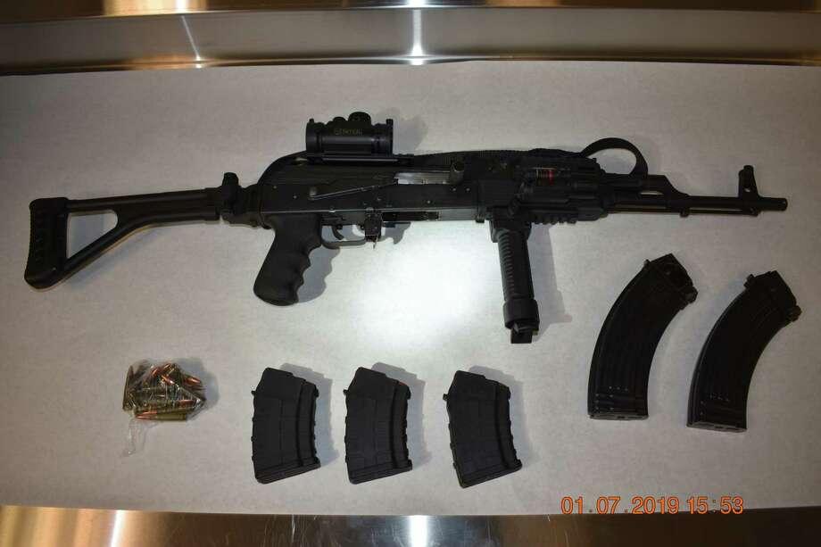 Troy police: AK-47, drugs found