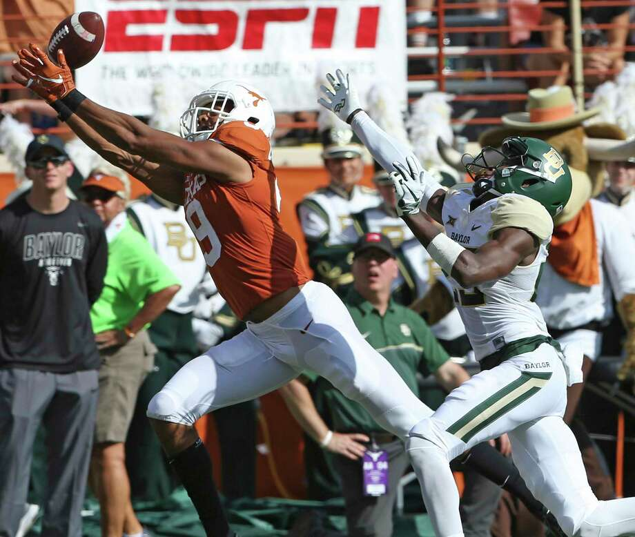 Longhorn receiver Collin Johnson gathers in a touchdown pass behind Derrek Thomas as UT hosts Baylor at DKR Stadium on October 13, 2018. Photo: Tom Reel, Staff / Staff Photographer / 2017 SAN ANTONIO EXPRESS-NEWS