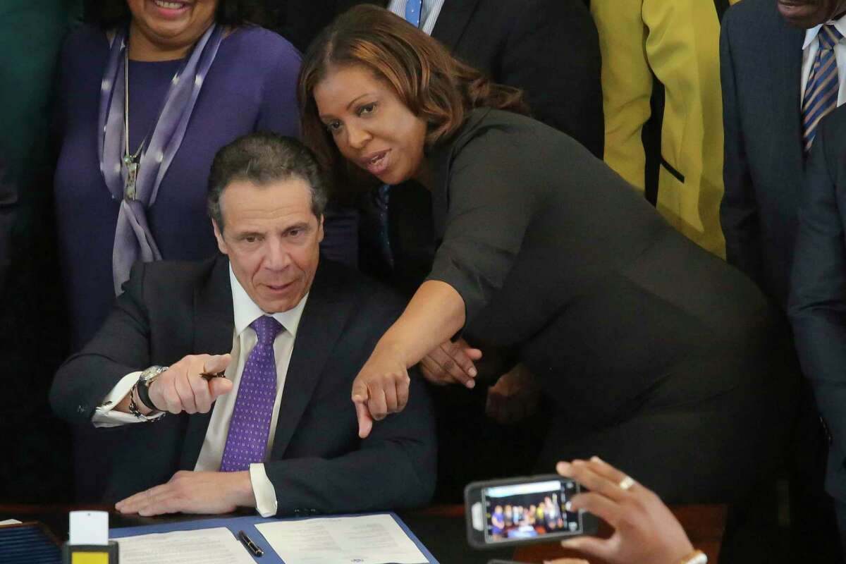 FILE - In this April 26, 2018, file photo, then-New York Public Advocate Letitia James, right, speaks with New York Gov. Andrew Cuomo, center, at an event in New York. President Donald Trump lashed out at New York?s governor and attorney general Monday, July 1, 2019, accusing the Democrats of going after him in a ?political Witch Hunt.? In four tweets, Trump accused Gov. Andrew Cuomo and Attorney General Letitia James of ?harassing all of my New York businesses in search of anything at all they can find to make me look as bad as possible.? (AP Photo/Bebeto Matthews, File)