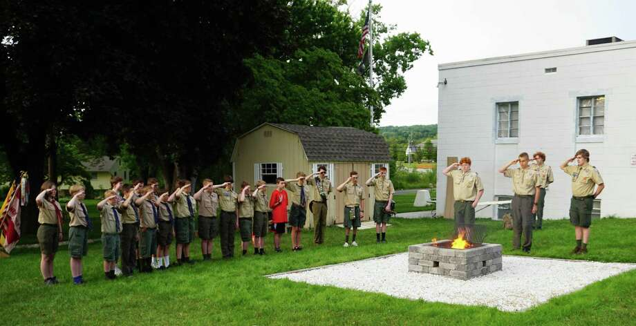 Boy Scout Troop 58 of New Milford recently conducted a U.S. flag retirement ceremony at the Andrew Mygatt, Veterans of Foreign Wars hall. Scouts are shown, from left to right, Brooke Thibodeau (visiting from Scouts BSA girls Troop 179), and Adam Zimmitti, Nicholas Sartori, Tyler Rogg, Ian Rocca, Chris Wologodzew, Bryson Miller, Alex Rogg, Jack Hartman, Evan Lovejoy, Alex Rigdon, Alex Thibodeau, Brendan Sartori, Ryan Zimmitti, Alex Pelletier, Jack Morrison, Connor Woods, Chris Miller, Jason Zimmitti, Bryce Lewis, Gabe Rocca, Senior Patrol Leader Dylan Lewis and Eagle Scout Ryan Thibodeau. The construction of the fire pit was Ryan's Eagle Scout project to benefit the VFW. Numerous businesses from the community made donations for the project. Photo: Courtesy Of Boy Scout Troop 58 / The News-Times Contributed