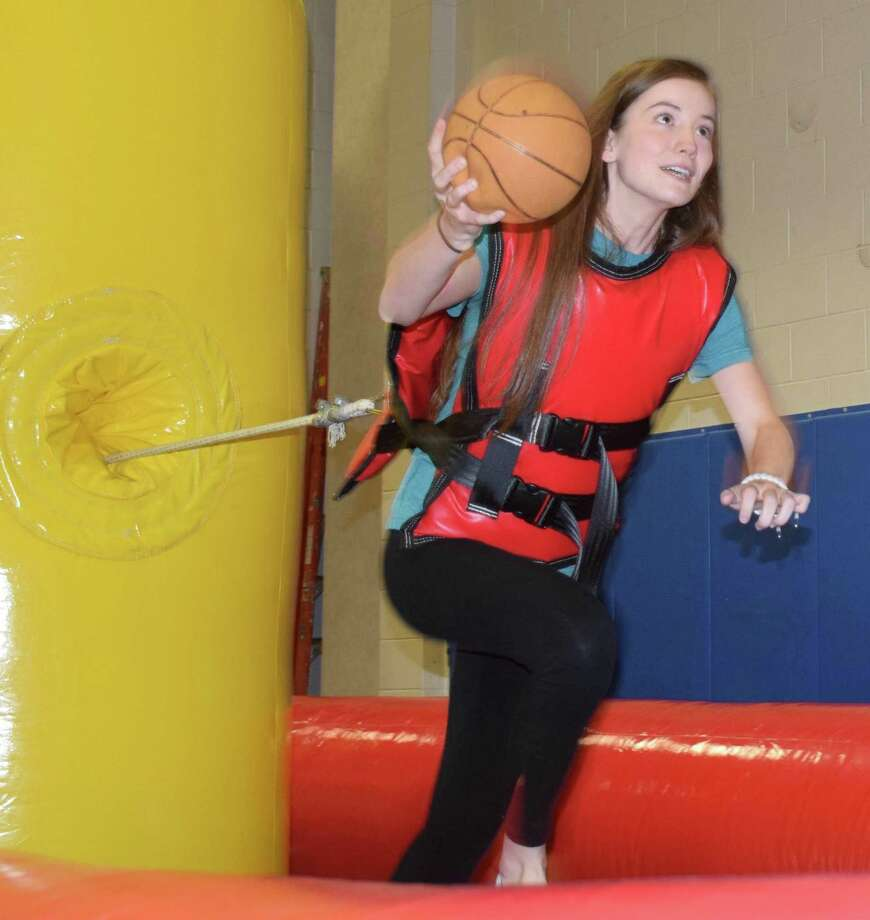 "Mackenzie Lane tries her hand at ""Tug and Dunk."" Photo: Deborah Rose / Hearst Connecticut Media / The News-Times  / Spectrum"