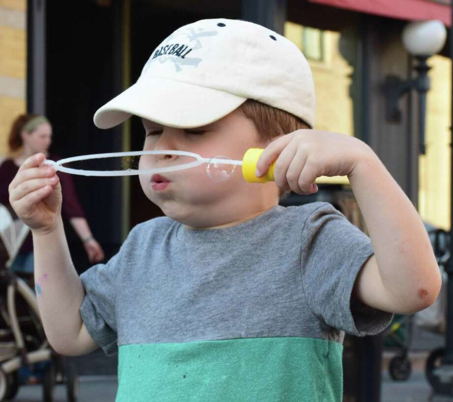 Cameron Gregory of New Milford, 3 1/2, gives his all blowing bubbles, one of the many child-friendly activities. Photo: Deborah Rose / Hearst Connecticut Media / The News-Times  / Spectrum