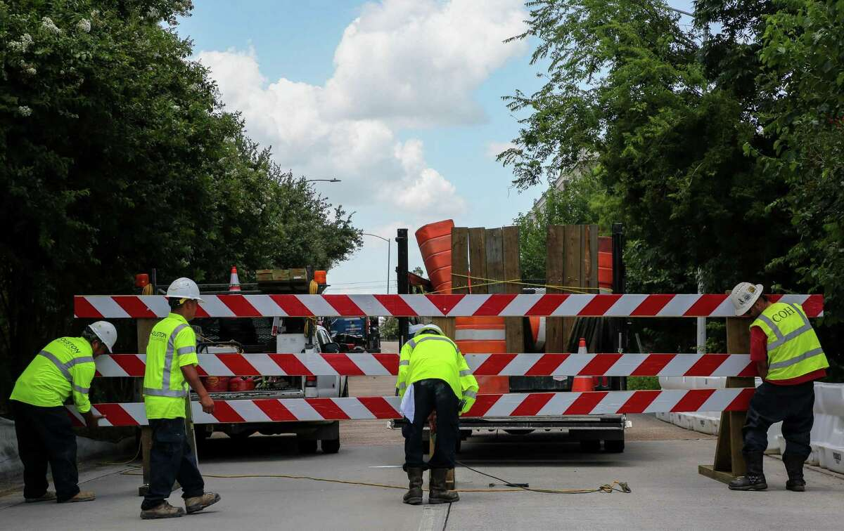 A Houston Public Works crew closes the bridge carrying Spur 527 to Brazos Street that runs over Smith Street, due to safety concerns, on July 1.