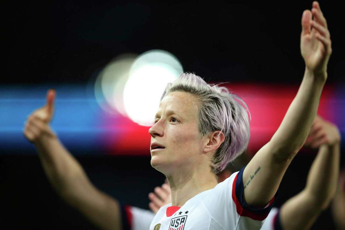 United States' Megan Rapinoe, center, celebrates after scoring her side's second goal during the Women's World Cup quarterfinal soccer match between France and the United States at the Parc des Princes, in Paris, Friday, June 28, 2019. (AP Photo/Francisco Seco)