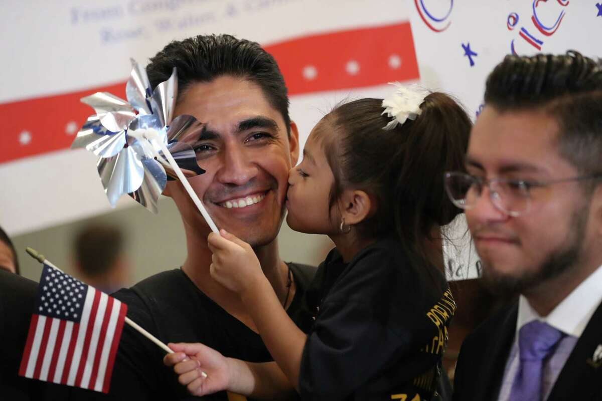 Jose Escobar, 33, arrived at Houston's George Bush Intercontinental Airport from El Salvador with a visa in hand accompanied by his family to stay in Houston for good this time. Escobar was accompanied by his wife Rose Escobar, his children Walter and Carmen and Congressman Al Green.