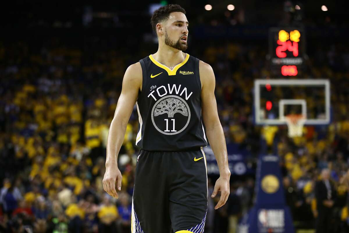 Klay Thompson #11 of the Golden State Warriors reacts in the first half against the Toronto Raptors during Game Six of the 2019 NBA Finals at ORACLE Arena on June 13, 2019 in Oakland, California.