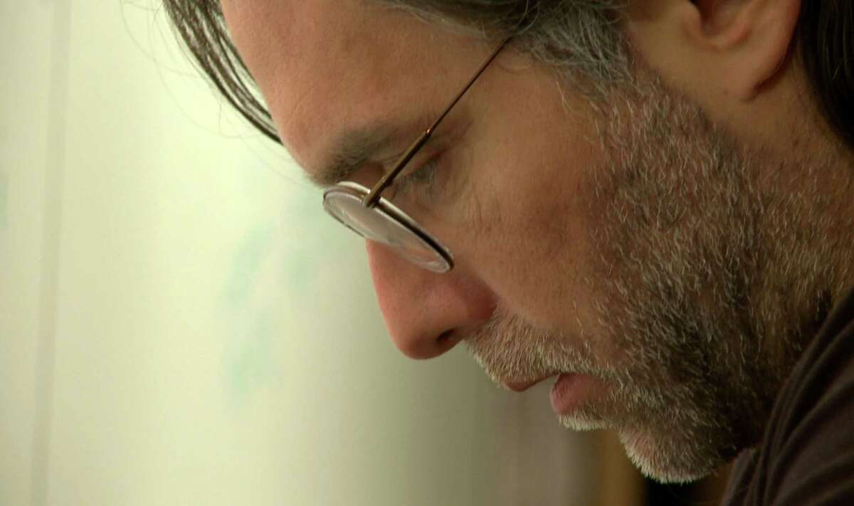 Keith Raniere is pictured at his 8 Hale Drive townhouse in a 2012 video in Halfmoon, N.Y. The video was submitted as evidence in the federal trial of Raniere. (U.S. Government exhibit)