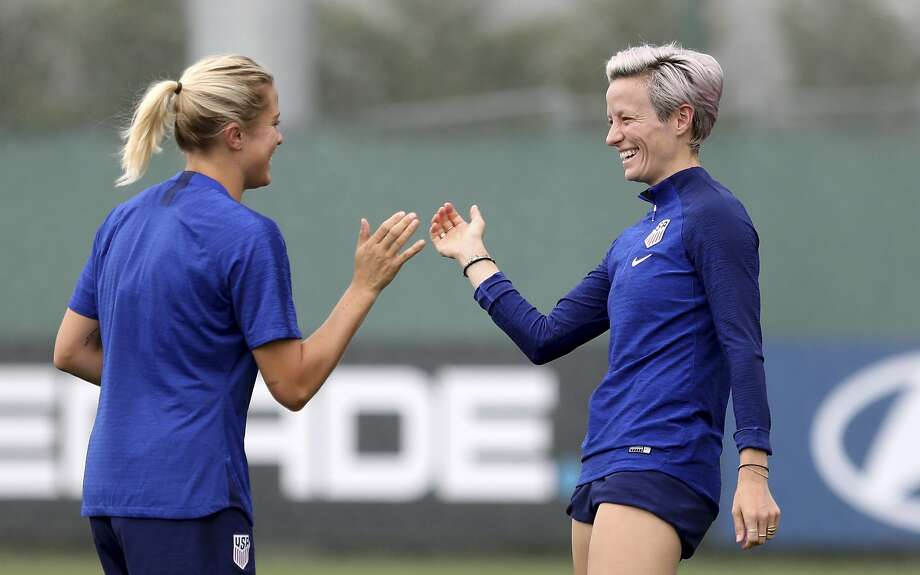 United States' Abby Dahlkemper, left, and Megan Rapinoe share a laugh during a training session of the US Women's Soccer team at a training ground in Lyon, France, Monday, July 1, 2019. The US will face England in a Women's World Cup semifinal match Tuesday in Lyon. (AP Photo/Laurent Cipriani) Photo: Laurent Cipriani, Associated Press