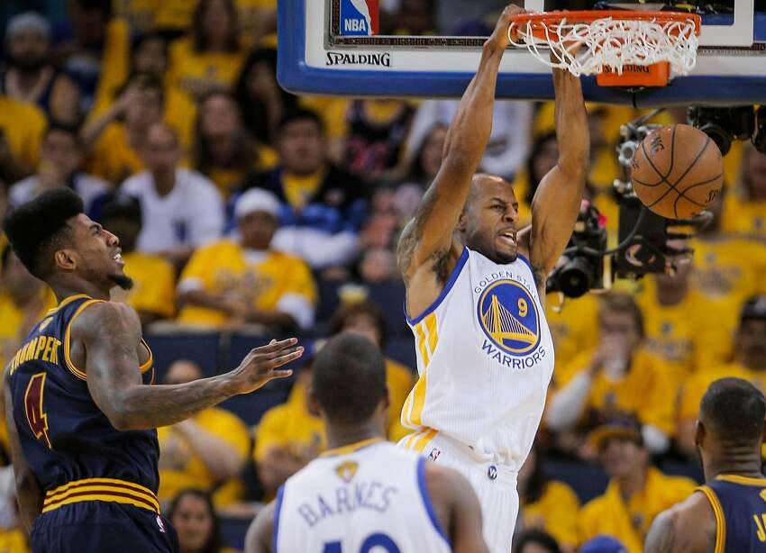 Golden State Warriors' Andre Iguodala dunks the ball in the third period during Game 5 of The NBA Finals between the Golden State Warriors and Cleveland Cavaliers at Oracle Arena on Sunday, June 14, 2015 in Oakland, Calif.
