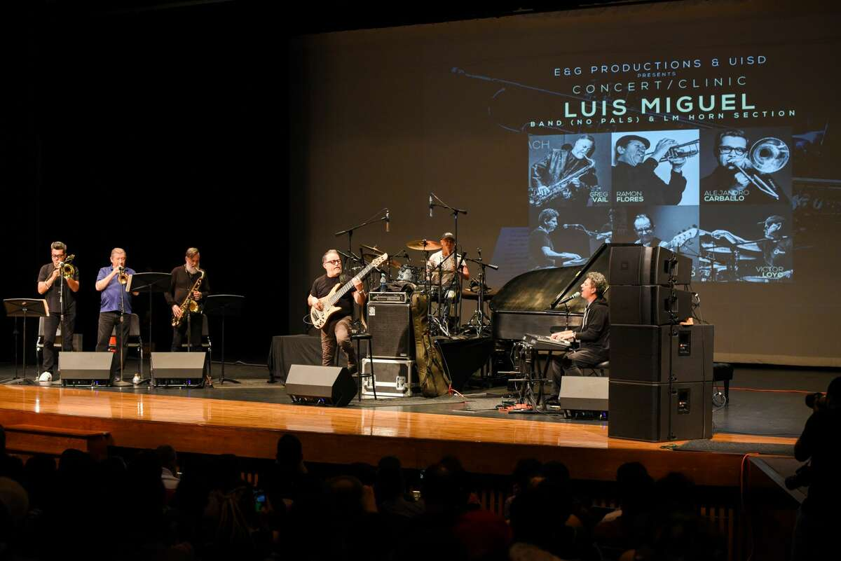 Members of the Luis Miguel Band (No Pals) & LM Horn Section perform during a concert/clinic, Monday, Jul 7, 2019, at the UISD Student Activity Complex.