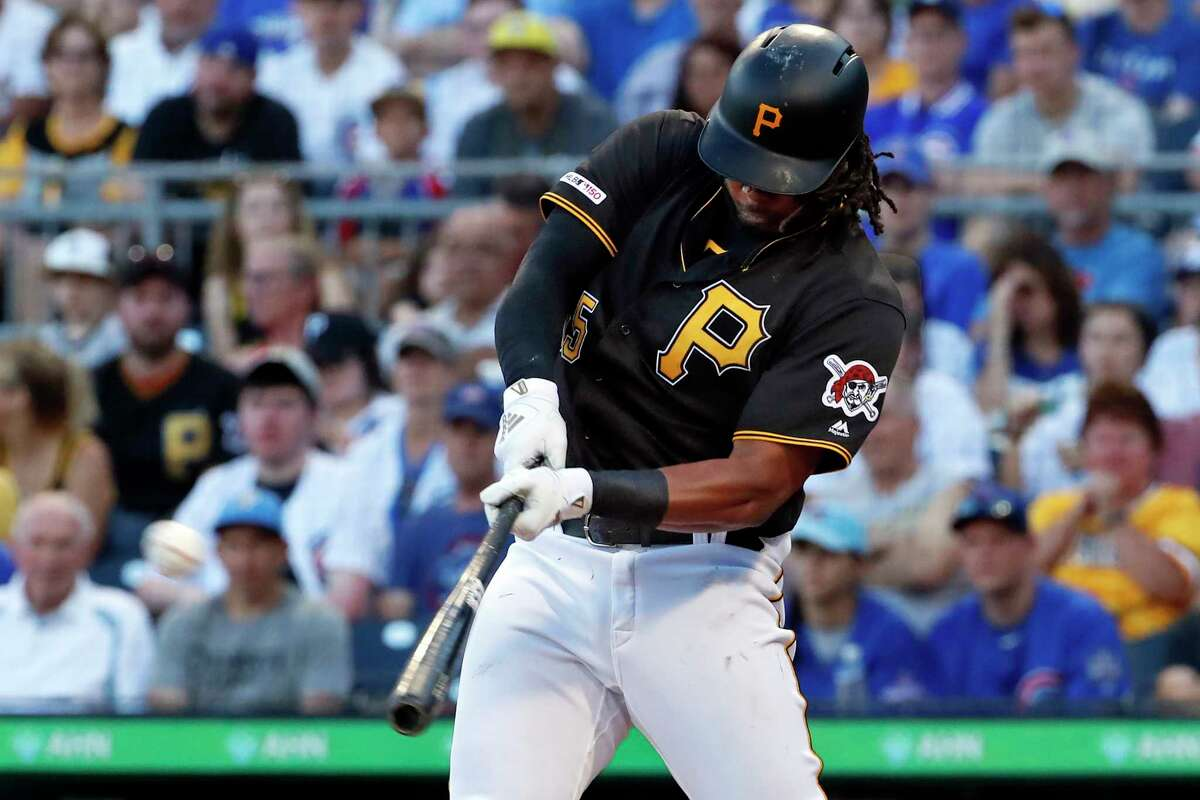 Pittsburgh Pirates' Josh Bell hits a three-run home run off Chicago Cubs starting pitcher Adbert Alzolay during the first inning of a baseball game in Pittsburgh, Monday, July 1, 2019. (AP Photo/Gene J. Puskar)