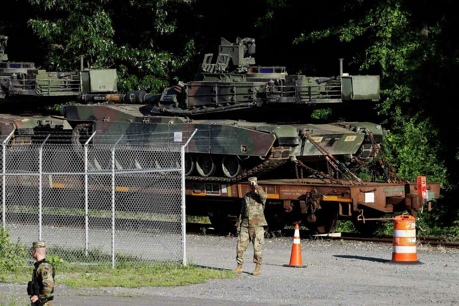 Military police walk near Abrams tanks on a flat car in a rail yard, Monday, July 1, 2019, in Washington, ahead of a Fourth of July celebration that President Donald Trump says will include military hardware. (AP Photo/Patrick Semansky) Photo: Patrick Semansky, STF / Associated Press / Copyright 2019 The Associated Press. All rights reserved.