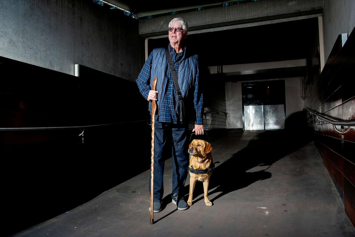 San Francisco Giants broadcaster Mike Krukow and his service dog Patriot at Oracle Park.