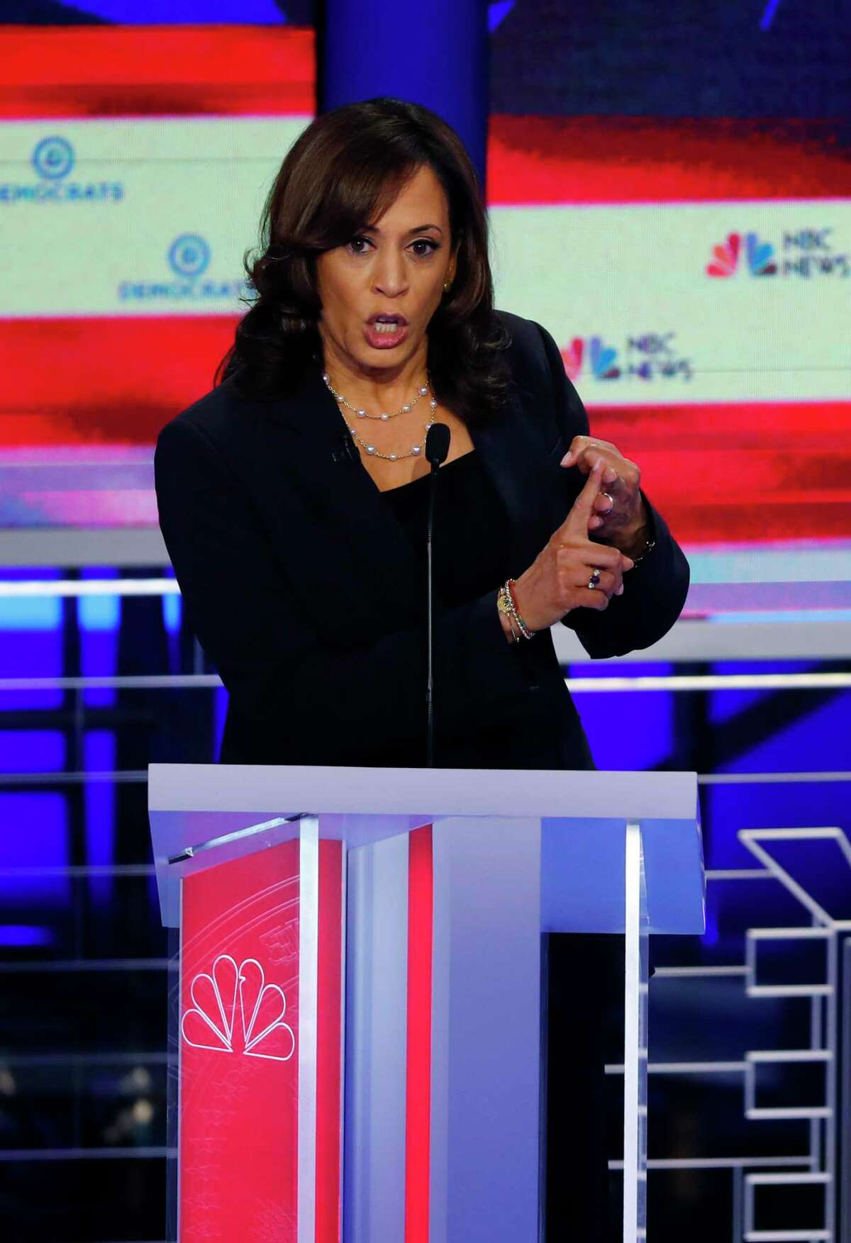Democratic presidential candidate Sen. Kamala Harris, D-Calif., gestures, during the Democratic primary debate hosted by NBC News at the Adrienne Arsht Center for the Performing Art, Thursday, June 27, 2019, in Miami. (AP Photo/Wilfredo Lee)