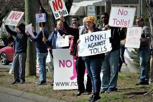 Protesters in Stratford called for passing cars to honk against tolls earlier this year.