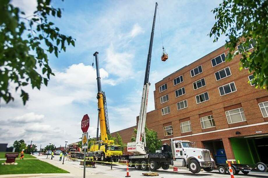 Gordon Street is closed as crews work to update equipment on cell towers at The H Hotel on Monday in downtown Midland. (Katy Kildee/kkildee@mdn.net)