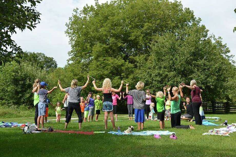 Chippewa Nature Center and Well-Bean are teaming up to provide a free program that blends yoga, nature, education, cooperative games, breathing and relaxation. (Photo provided/CNC)