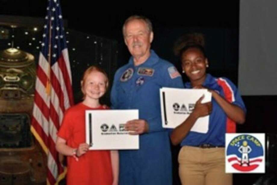 Caroline McCulloch, 10, of Midland Christian School, left, recently attended Space Camp at the U.S. Space and Rocket Center. (Photo provided)