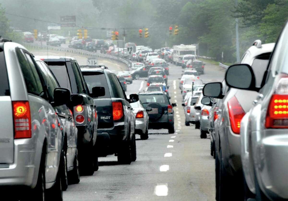 In a file photo, cars lined up in bumper-to-bumper traffic to get into Hammonasset State Park in Madison. This week Gov. Ned Lamont asked state park officials to consider ways to reduce the number of vehicles entering state parks during the coronavirus pandemic.