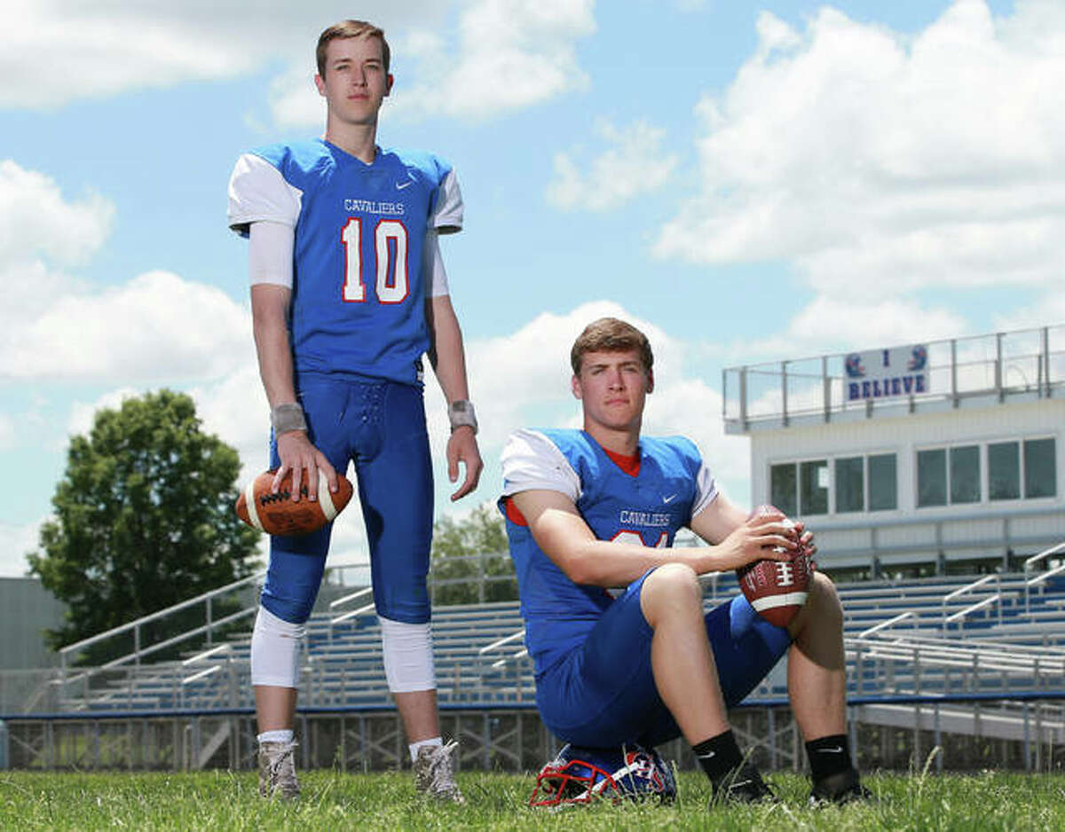 Carlinville seniors Jarret Easterday and Kyle Dixon share recognition as the 2018 Telegraph Small-Schools Football Players of the Year after posting record-setting numbers in the Cavaliers' 12-1 season.