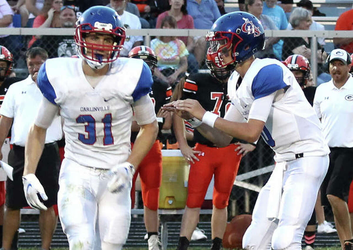 Carlinville WR Kyle Dixon (31) goes in motion while quarterback Jarret Easterday waits for the snap during a Cavaliers victory at Gillespie in Week 2. Of Easterday's 44 TD passes as a senior, 21 went to Dixon.