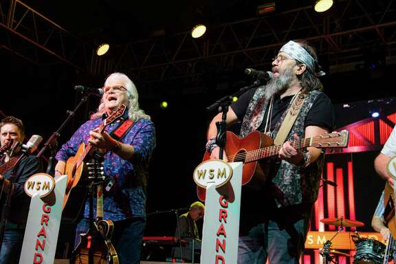 Ricky Skaggs, left, and Steve Earle perform during the Grand Ole Opry show at the Bonnaroo Music and Arts Festival on Thursday, June 13, 2019, in Manchester, Tenn. (Photo by Amy Harris/Invision/AP)