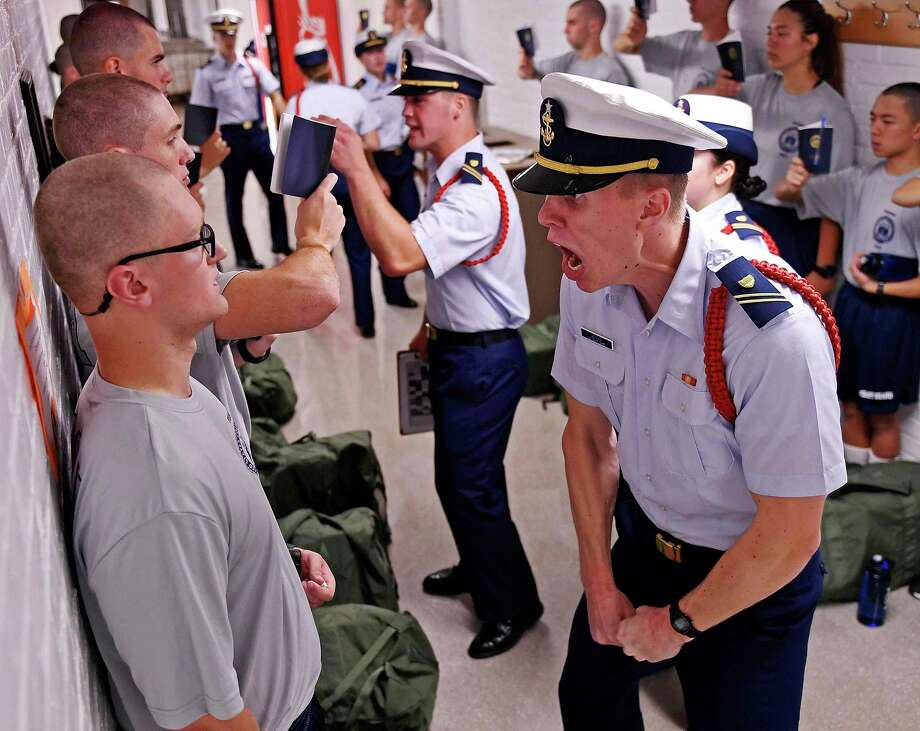 Whisky 2 company Cadre Jacob Denns, right, shouts instructions to swab Nicolas Fisher, left, of Pelham, New Hampshire, during haircut and mailbox issue for the U.S. Coast Guard Academy Class of 2023 on Day One of Swab Summer Monday, July 1, 2019 in New London, Conn. Day One is the beginning of the seven-week indoctrination to military academy life for the future coast guard officers. Photo: Sean D. Elliot / Associated Press / 2019 The Day Publishing Company