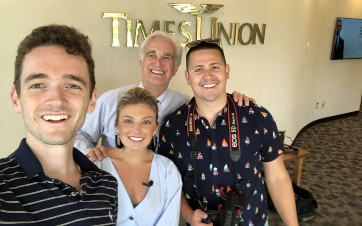 Jack Carpenter, Taylor Rao and John Longton of Two Buttons Deep (foreground), and Times Union Editor Rex Smith pose for a selfie July 1, 2019, as a summer partnership between the Times Union and Two Buttons Deep has been announced.