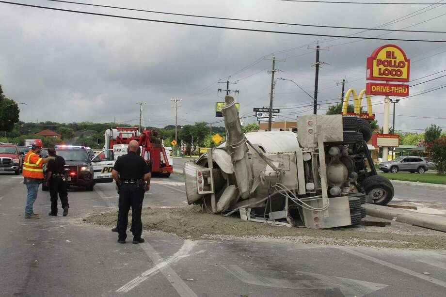 A concrete truck rolled over during a right turn onto Culebra Road near Tezel and Grissom roads on July 2, 2019. Photo: Fares Sabawi/San Antonio Express-News