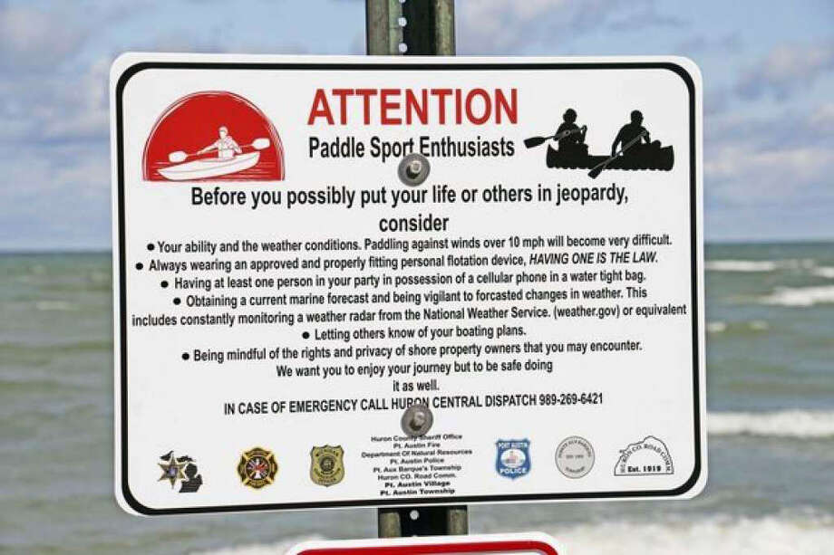 A few years ago, 12 signs were placed in popular launch locations throughout the area in hopes of helping keep people safe during busy holiday weekends. Photo: Tribune File Photo